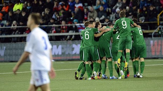 Ireland's national team football players celebrate after Jonathan Walters (hidden) scored during the FIFA 2014 World Cup group C qualifying football match Faroe Islands vs Republic of Ireland at the Torsvollur stadium in Torshavn (AFP)