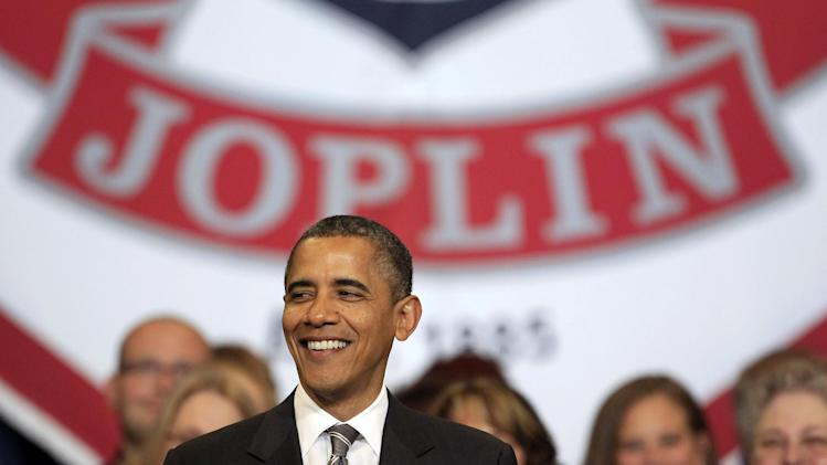 President Barack Obama speaks at the Joplin High School commencement ceremony, Monday, May 21, 2012, at Missouri Southern State University in Joplin, Mo. (AP Photo/Charlie Riedel)