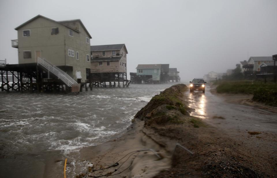 Abandoned beach front houses are surrounded by rising water as the effects of Hurricane Irene are felt in Nags Head, N.C., Saturday, Aug. 27, 2011  (AP Photo/Gerry Broome)