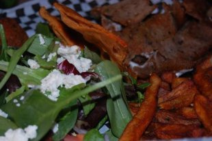 Gyro Platter. The platter comes with homemade seasoned fries, a side salad and gyro meat served with pita chips!!! Of course that is feta cheese, honey! Anything else would be uncivilized!