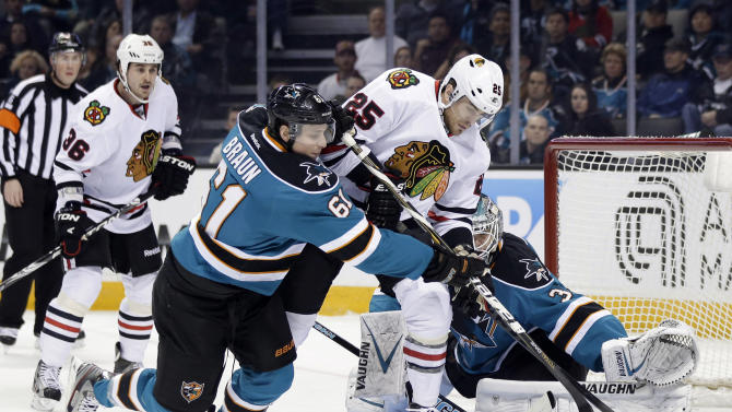 Chicago Blackhawks left wing Viktor Stalberg (25), of Sweden, works against San Jose Sharks defenseman Justin Braun (61) during the first period of an NHL hockey game in San Jose, Calif., Tuesday, Feb. 5, 2013. (AP Photo/Marcio Jose Sanchez)
