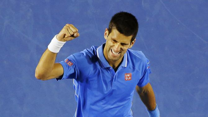 Djokovic of Serbia celebrates a point over Muller of Luxembourg during their men's singles match at the Australian Open 2015 tennis tournament in Melbourne