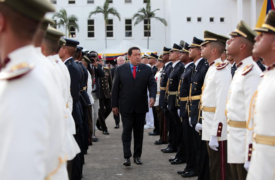 In this photo provided by Miraflores Presidential Press Office, Venezuela's President Hugo Chavez, center, attends a military ceremony at Fuerte Tiuna in Caracas, Venezuela, Sunday, July 8, 2012. (AP Photo/Miraflores Presidential Office)