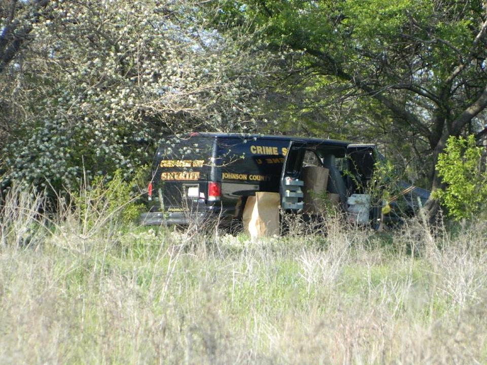 Crime scene investigators continue to look for evidence Tuesday evening, May 7, 2013 at a house in a rural area west of Ottawa, Kan., after three bodies were discovered at the location.  The bodies of two adult men and one woman were found Monday on the farm. (AP Photo/The Topeka Capital Journal, Ann Bush)