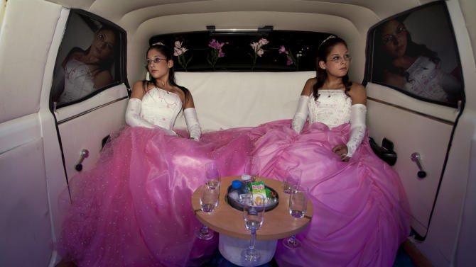 IMAGE DISTRIBUTED ON BEHALF OF THE SONY WORLD PHOTOGRAPHY AWARDS - Winner of the Professional Arts and Culture Professional category in the 2013 Sony World Photography Awards is Myriam Meloni from Italy. This photo shows twins Laura and Bela on their fifteenth birthday in the back of a limousine in Buenos Aires, Argentina. (Myriam Meloni/Sony World Photography Awards via AP Images)