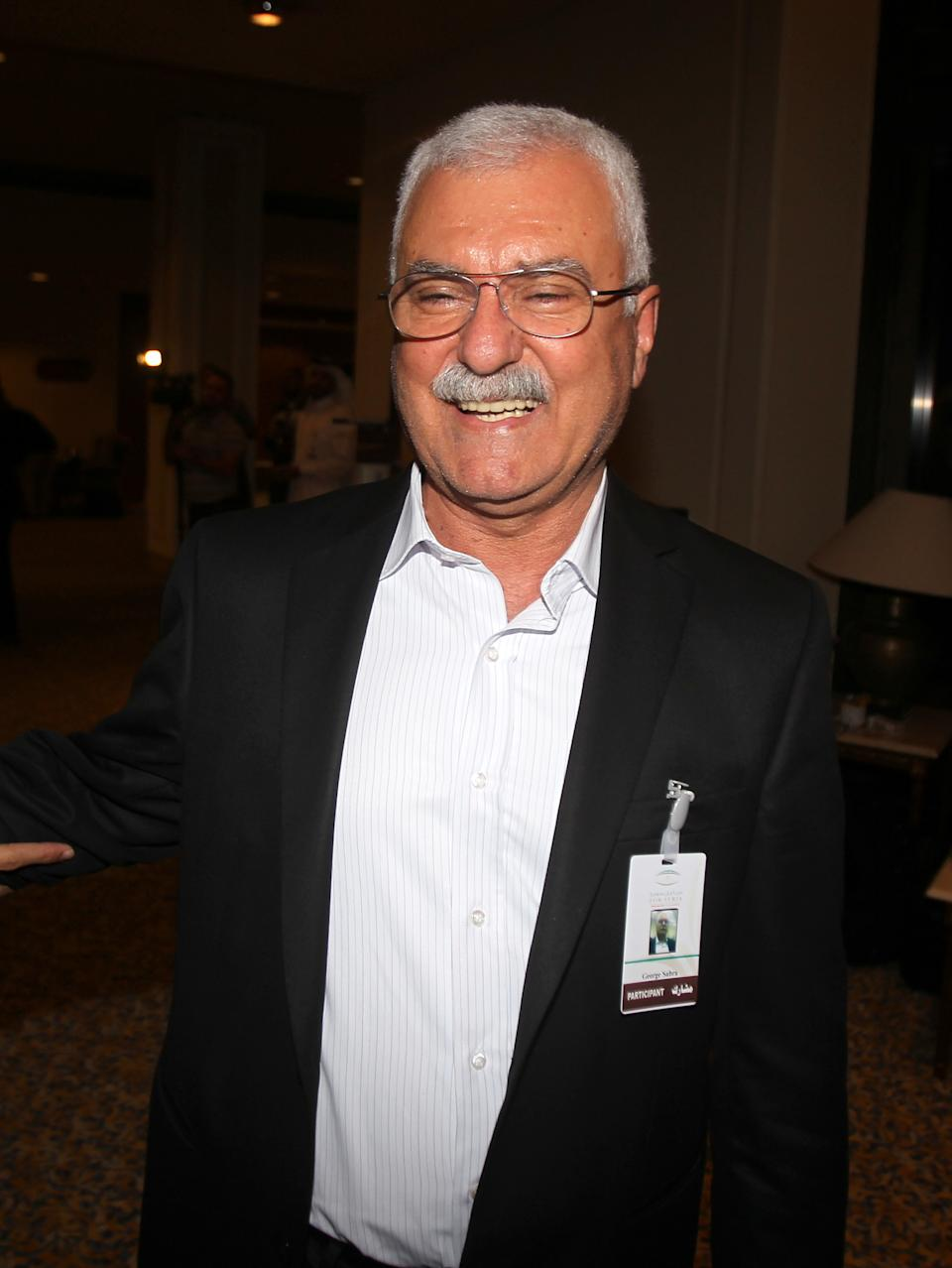 Council member George Sabra arrives at the meeting of the General Assembly of the Syrian National Council in Doha, Qatar,Thursday, Nov. 8, 2012. (AP Photo/Osama Faisal)