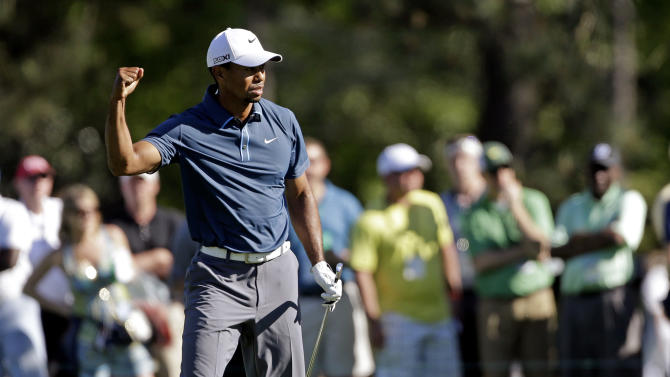 Tiger Woods reacts to his approach shot to the 15th green during the third round of the Masters golf tournament Saturday, April 13, 2013, in Augusta, Ga. (AP Photo/David Goldman)