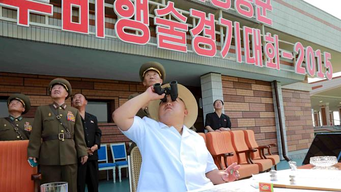 """North Korean leader Kim Jong Un guided the """"2015 combat aeronautics contest of air commanding officers of the Air and Anti-Air Force of the Korean People's Army""""  at Kalma Airport in this undated photo released by KCNA"""