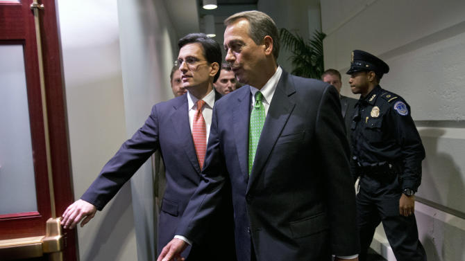 House Majority Leader Eric Cantor, R-Va., left, with Speaker of the House John Boehner, R-Ohio, enters a second Republican caucus meeting at the U.S. Capitol in Washington, on Tuesday, Jan. 1, 2013. (AP Photo/Jacquelyn Martin)