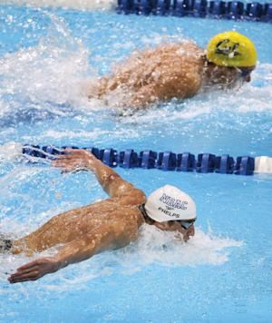 Michael Phelps and Tom Shields, top, swim in the men's 200-meter butterfly final at the U.S. Olympic swimming trials, Sunday, July 1, 2012, in Omaha, Neb. Phelps won the final. (AP Photo/Nati Harnik)