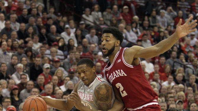 Ohio State's Lenzelle Smith, left, drives to the basket against Indiana's Christian Watford during the first half of an NCAA college basketball game on Sunday, Feb. 10, 2013, in Columbus, Ohio. (AP Photo/Jay LaPrete)