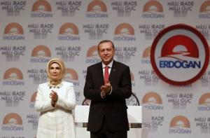 Turkey's Prime Minister and presidential candidate Tayyip Erdogan and his wife Emine greet their supporters at the end of a meeting to launch his election campaign in Istanbul