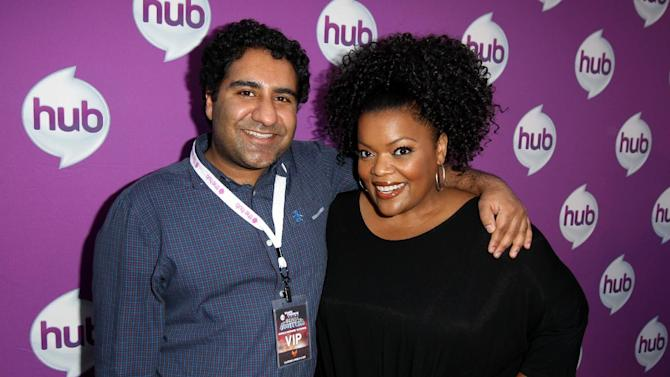 """Actors Parvesh Cheena, left, and Yvette Nicole Brown arrive at The Hub's """"Transformers Prime Beast Hunters"""" World Premiere Screening Event on Thursday, March 14, 2013 in Universal City, Calf. (Photo by Matt Sayles/Invision for The Hub/AP Images)"""