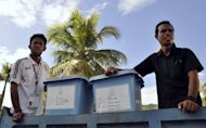 East Timorese election officials prepare to distribute ballot boxes in Dili. Former military commander Taur Matan Ruak was ahead in an early count for East Timor's presidential run-off vote on Monday, according to the elections secretariat