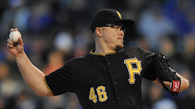 Pittsburgh Pirates starter Vance Worley delivers a pitch during the first inning of an MLB baseball game against the Chicago Cubs Monday, April 27, 2015 in Chicago.  (AP Photo/Paul Beaty)