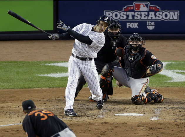 New York Yankees' Raul Ibanez hits an RBI single against Baltimore Orioles pitcher Jason Hammel during the fifth inning in Game 5 of the American League division baseball series on Friday, Oct. 12, 20