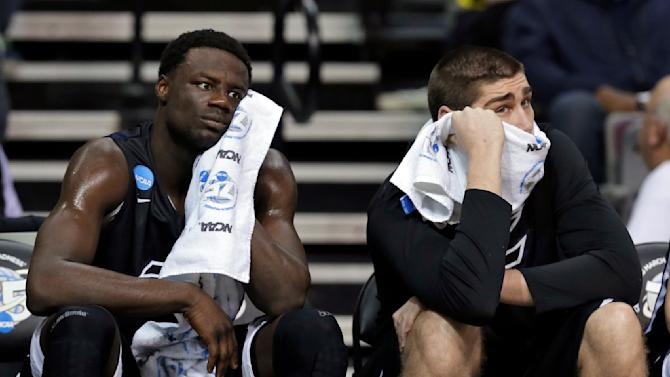 Akron forward Demetrius Treadwell, left, and teammate Pat Forsythe watch from the bench against Virginia Commonwealth in the first half of a second-round game of the NCAA men's college basketball tournament in Auburn Hills, Mich., Thursday, March 21, 2013. (AP Photo/Paul Sancya)