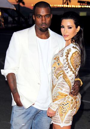 Kim Kardashian Wears Low-Cut Sexy Dress at Kanye West's Cannes Film Premiere