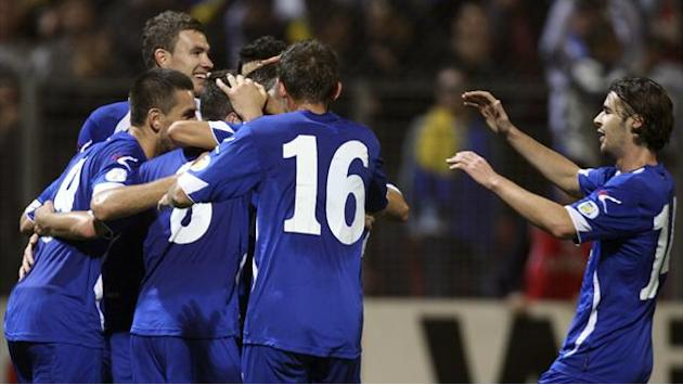 Football: Bosnia continue hot streak, Greece win in Slovakia