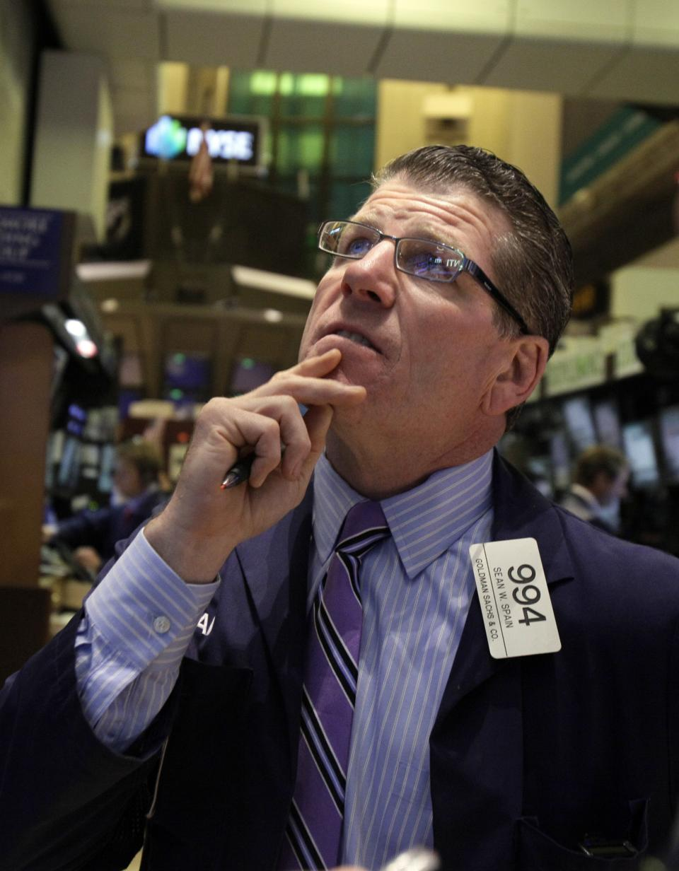 FILE -- A July 26, 2012 file photo shows trader Sean Spain working on the floor of the New York Stock Exchange. A stock market rally lost steam Wednesday Aug. 8, 2012 after mixed earnings from U.S. companies added to fears about Europe's economic slowdown.   (AP Photo/Richard Drew/file)