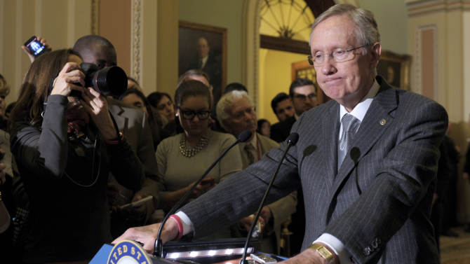 FILE - In this Dec. 18, 2012, file photo, Senate Majority Leader Harry Reid of Nevada speaks to reporters following the Democratic policy luncheon on Capitol Hill in Washington. Senate Majority Leader Harry Reid's office says the senator was never involved in a deal to have a Utah businessman pay Reid to make a federal investigation disappear. (AP Photo/Susan Walsh, File)