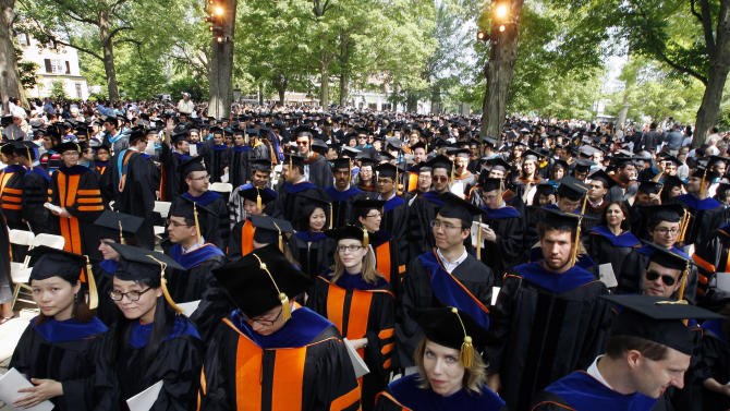 """Members of the class of 2011 are seen during commencement at Princeton University, Tuesday, May 31, 2011, in Princeton, N.J. The former home run record-holder Baseball Hall of Famer Hank Aaron was awarded an honorary doctorate of humanities for making America a better place with his """"imperishable example of grace under pressure."""" (AP Photo/Mel Evans)"""
