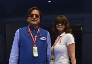 Sunanda, wife of India's Minister of State for Human Resource Development Tharoor, poses with her husband at the Indian F1 Grand Prix at Buddh International Circuit in Greater Noida