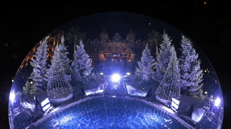 The Monte Carlo Casino is reflected in a giant mirror as part of Christmas holiday season decorations in Monaco