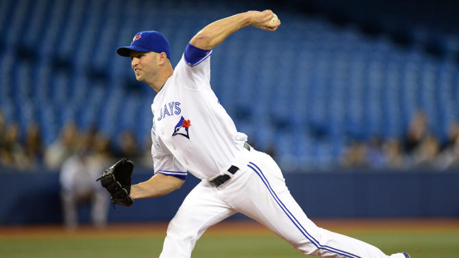 Toronto Blue Jays pitcher J.A. Happ throws against the Seattle Mariners in the first inning during a baseball game, Monday, Sept. 22, 2014 in Toronto. (AP Photo/The Canadian Press, Frank Gunn)