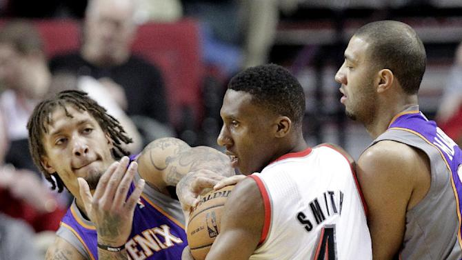 Portland Trail Blazers guard Nolan Smith (4) is double-teamed by Phoenix Suns' Michael Beasley, left, and Kendall Marshall  during the first half of an NBA basketball game in Portland, Ore., Tuesday, Feb. 19, 2013. (AP Photo/Don Ryan)