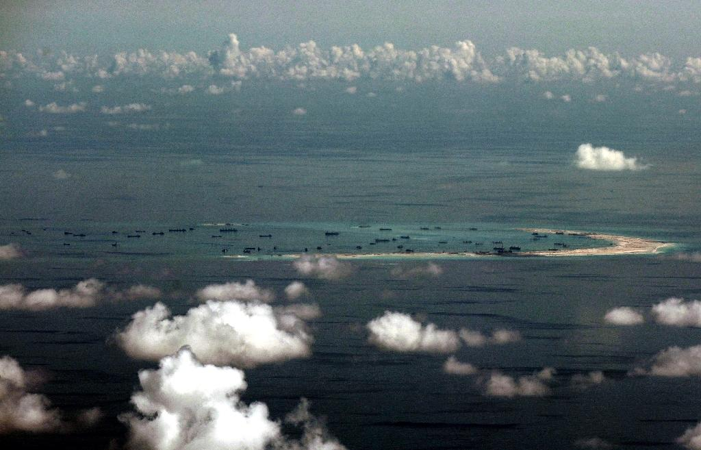 US hits out at China over sea reclamation, vows more patrols