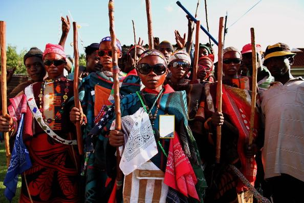 SEBOKENG, SOUTH AFRICA - JANUARY 7: (SOUTH AFRICA OUT) A group of young boys return home from an initiation school on January 7, 2013 in Sebokeng, South Africa. In the African culture young boys go th