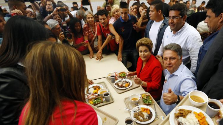 Presidential candidate and Brazilian President Rousseff and Governor candidate of Rio de janeiro Garotinho visit a popular restaurant during a re-election campaign rally in Rio de Janeiro