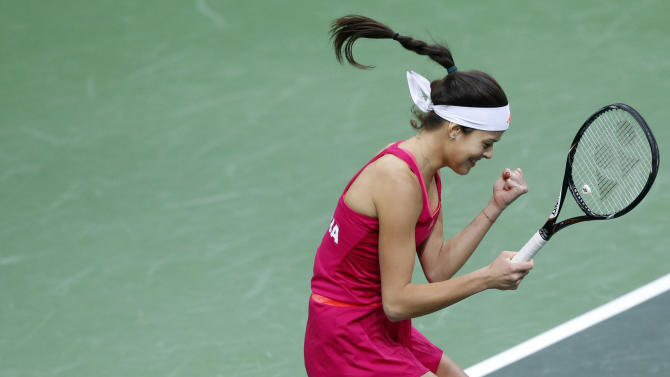 Serbia's Ana Ivanovic celebrates after defeating Petra Kvitova from Czech Republic in their Fed Cup  final tennis match in Prague, Czech Republic, Sunday, Nov. 4, 2012. Czech Republic leads Serbia 2-1. (AP Photo/Petr David Josek)