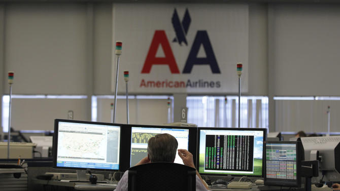 FILE - In this January 26, 2012, file photo, shows the flight control center at American Airlines headquarters in Fort Worth, Texas. Travelers stranded by Hurricane Sandy are seeing service slowly restored across the Northeast. But it'll be days before things are close to normal.  (AP Photo/LM Otero)