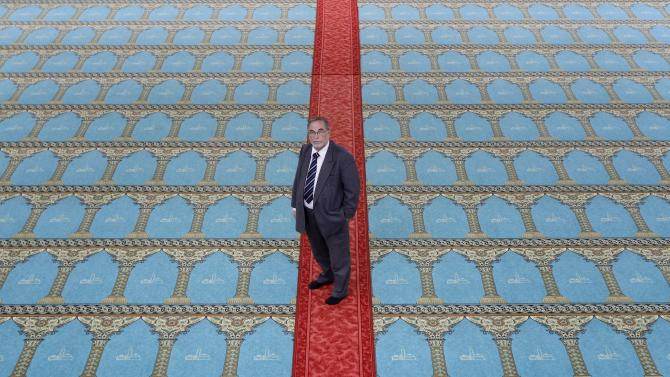 FILE - In this April, 28, 2011 file photo, Kamel Kabtane, the rector of the Grand Mosque of Lyon, poses in the mosque in Lyon, central France. They are France's millions-strong minority with a voice that usually falls silent at election time. But this year, there is a special new effort to mobilize French Muslims to speak up at the ballot box in Sunday's presidential race. (AP Photo/Laurent Cipriani, File)