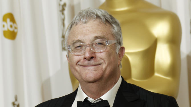 """FILE - This Feb. 27, 2011 file photo shows composer Randy Newman posing backstage with the Oscar for best original song  for """"We Belong Together"""" from """"Toy Story 3"""" at the 83rd Academy Awards in the Hollywood section of Los Angeles. Newman is weighing in on the presidential election, and he's playing the race card through a song he wrote. I'm Dreaming"""" is full of satirical, sarcastic _ and signature Newman _ anecdotes about someone who votes for the president because he is white. It features the refrain: """"I'm dreaming of a white president."""" Newman is openly supporting President Barack Obama. He says though the song is serious, he wants the public to find comedic relief in it.(AP Photo/Matt Sayles, File)"""