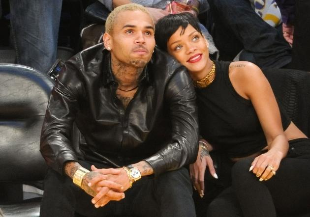 Chris Brown & Rihanna get close during the Los Angeles Lakers/New York Knicks game on December 25, 2012 in Los Angeles  -- Getty Premium