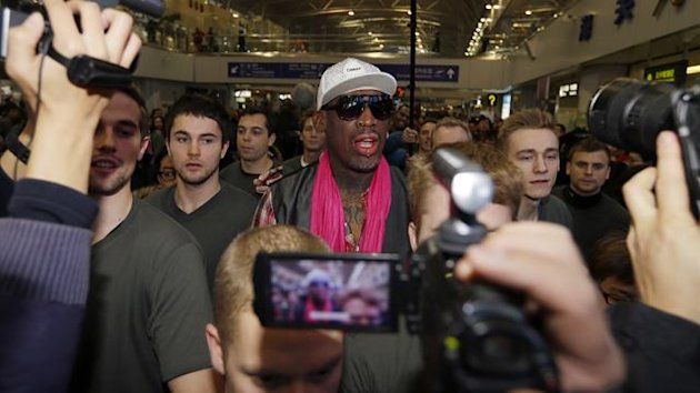Former NBA basketball player Dennis Rodman talks to journalists as he arrives at the Beijing Capital International Airport to leave for Pyongyang, in Beijing, January 6, 2014 (Reuters)