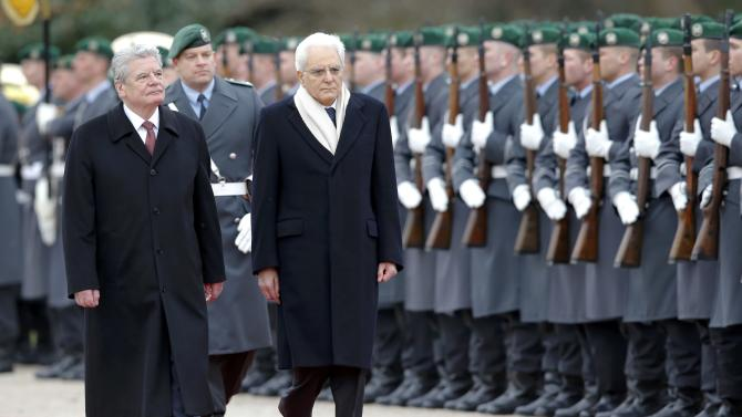 German President Gauck and Italy's President Mattarella inspect an honour guard during a welcoming ceremony at Bellevue presidential palace in Berlin