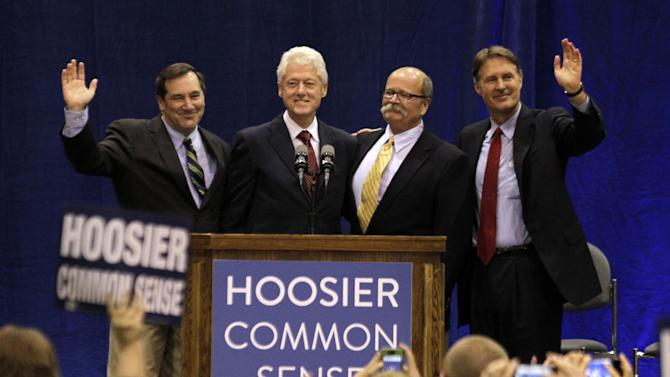 """Former President Bill Clinton, second from left, and former Indiana Sen. Evan Bayh, right, pose with Indiana Democratic Senate candidate Joe Donnelly, left, and Indiana Democratic gubernatorial candidate John Gregg, second from right, before Clinton spoke at """"Hoosier Common Sense"""" rally in Indianapolis, Friday, Oct. 12, 2012.  (AP Photo/Michael Conroy)"""