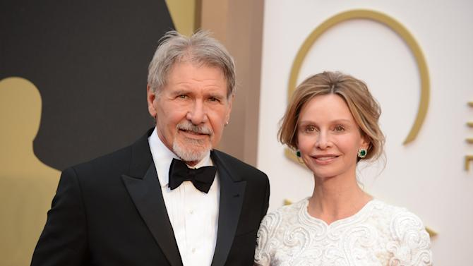 FILE - In this March 2, 2014 file photo, Harrison Ford, left, and Calista Flockhart arrive at the Oscars at the Dolby Theatre in Los Angeles. Ford crash-landed his vintage airplane at a Los Angeles golf course Thursday, March 5, 2015, an official said. He suffered moderate injuries and was taken to a hospital.  (Photo by Jordan Strauss/Invision/AP, File)