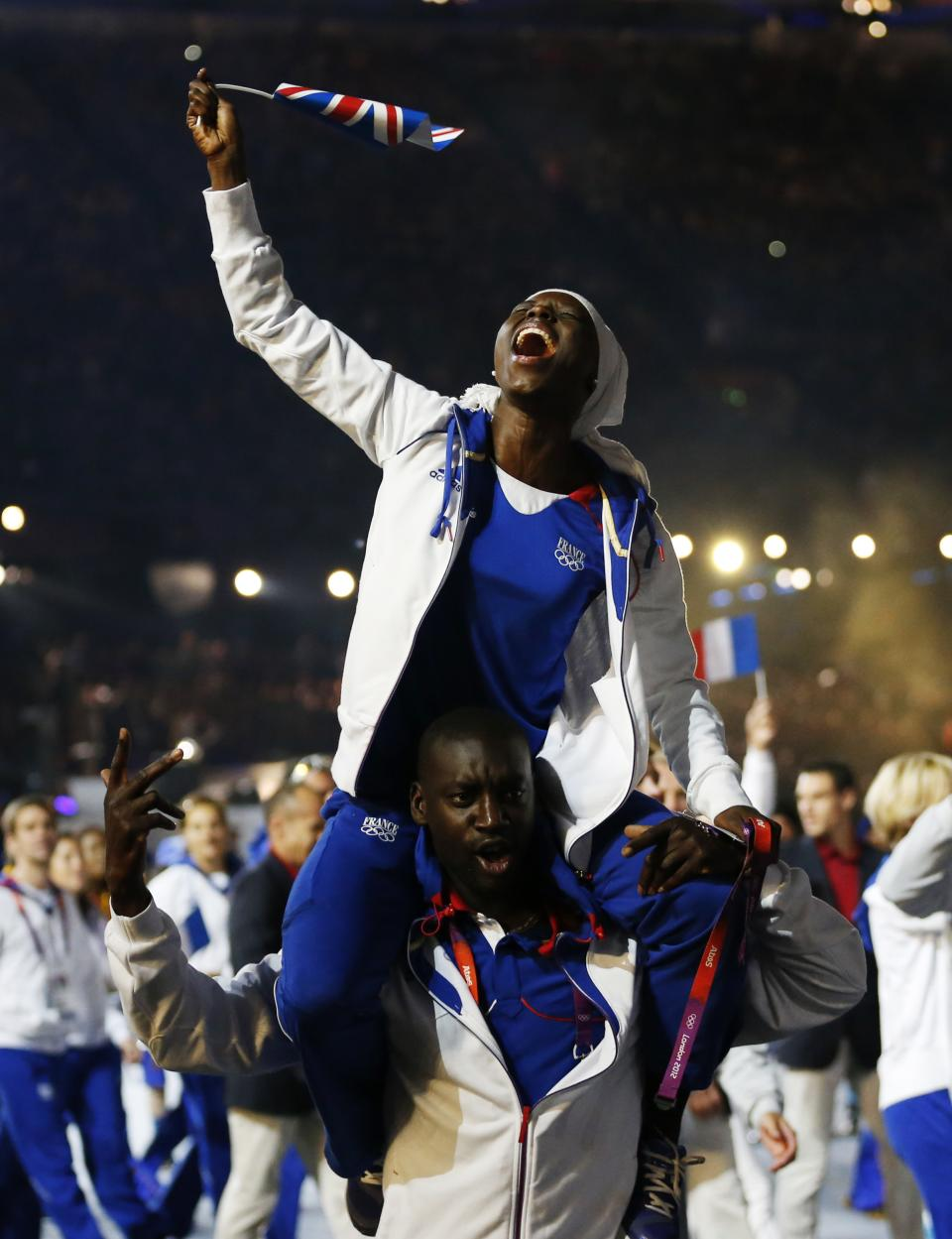 French athletes parade during the Closing Ceremony at the 2012 Summer Olympics, Sunday, Aug. 12, 2012, in London. (AP Photo/Matt Dunham)