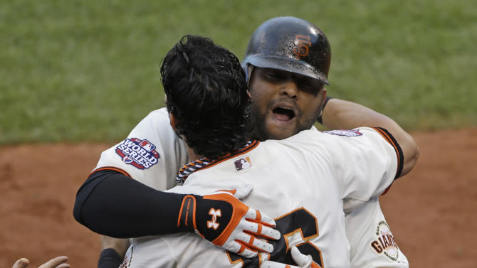 San Francisco Giants' Pablo Sandoval is congratulated by Angel Pagan after Sandoval hit a home run during the first inning of Game 1 of baseball's World Series Wednesday, Oct. 24, 2012, in San Francisco. (AP Photo/Jeff Chiu)