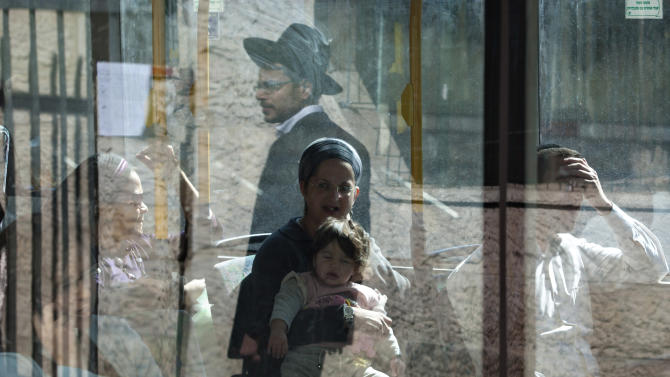FILE - In this Monday, Nov. 7, 2011 file photo, an Ultra Orthodox Jewish man is reflected on a bus window in Jerusalem. One of Israel's chief rabbis ventured into the divisive question of gender segregation on Monday, Dec. 5, 2011, saying extreme practices adopted by some devout Jews, including separate seating on buses, are not required by Jewish law. (AP Photo/Sebastian Scheiner, File)