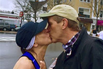 Runner tries to find man she kissed at Boston Marathon, finds his wife