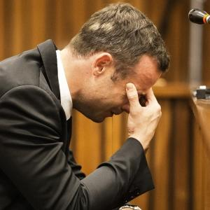 Raw: Pistorius Covers Head During Testimony