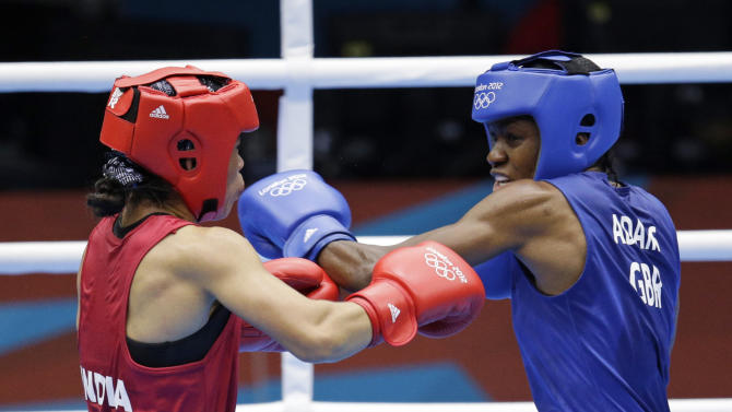 Great  Britain's Nicola Adams, right, and India's Chungneijang Mery Kom Hmangte fight during their women's flyweight 51-kg semifinal boxing match at the 2012 Summer Olympics, Wednesday, Aug. 8, 2012, in London. (AP Photo/Patrick Semansky)