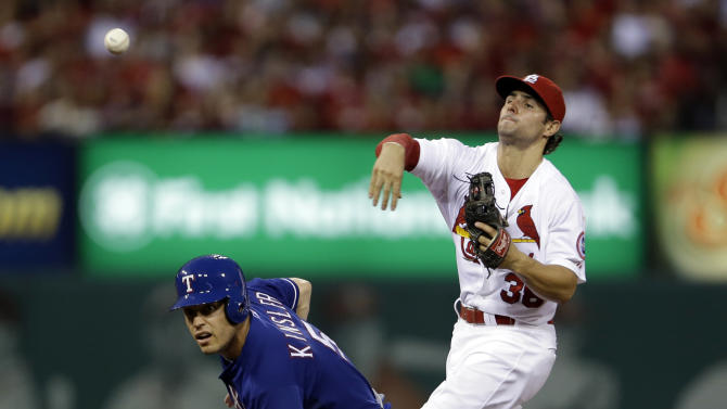 Texas Rangers' Ian Kinsler, left, is out at second as St. Louis Cardinals shortstop Pete Kozma fails to turn the double play during the fourth inning of a baseball game on Friday, June 21, 2013, in St. Louis. Rangers' Elvis Andrus was safe at first. (AP Photo/Jeff Roberson)