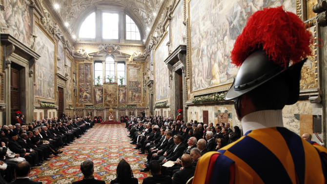 """Pope Benedict XVI delivers his speech during an audience with foreign ambassadors to the Holy See, at the Vatican, Monday, Jan. 7, 2013. The pontiff urged diplomats to supply urgent aid to Syria to relieve civilian suffering, while expressing hope that Jerusalem would become """"a city of peace and not of division."""" (AP Photo/Giampiero Sposito, Pool)"""